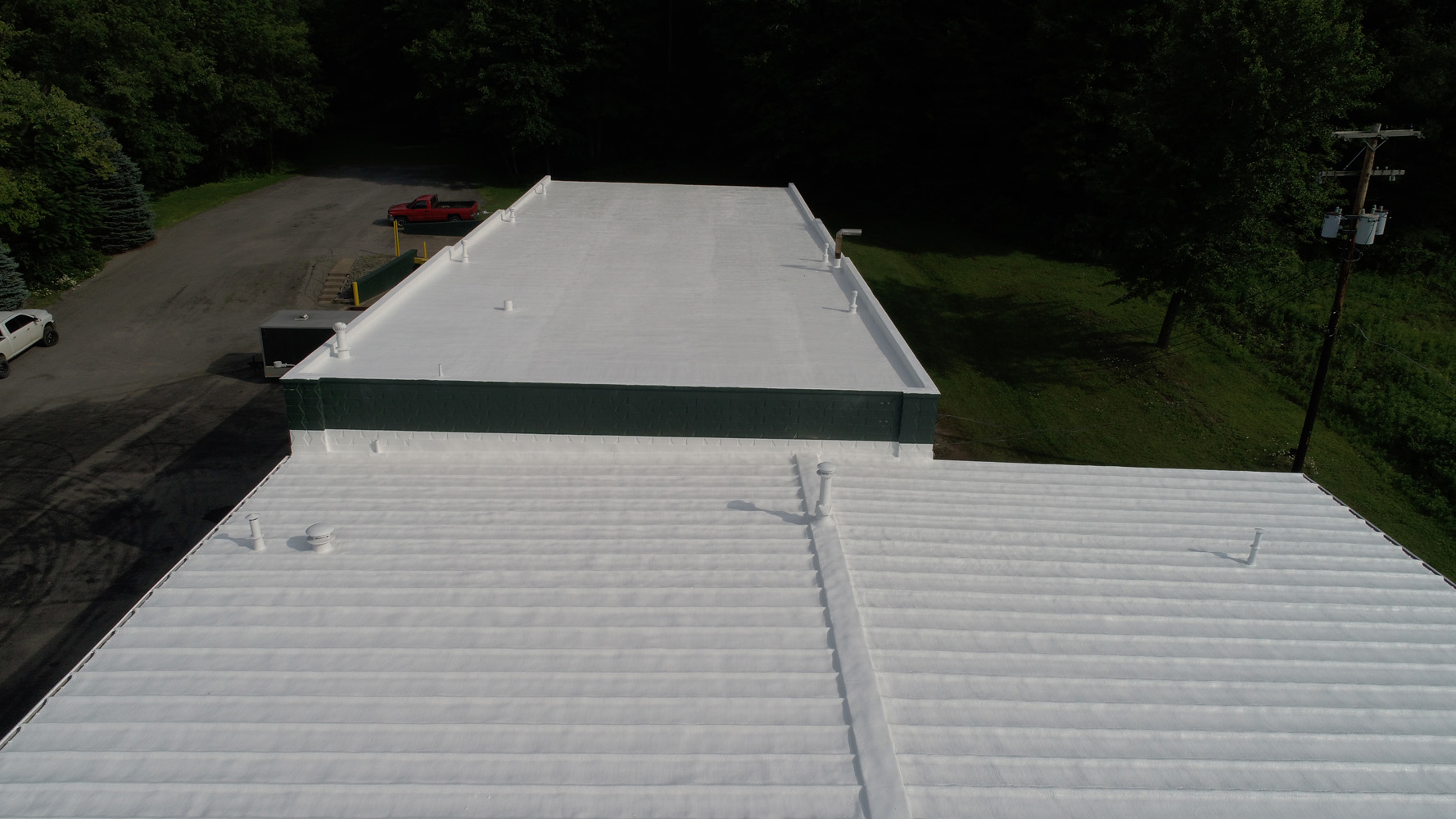 an completed commercial roof coating project
