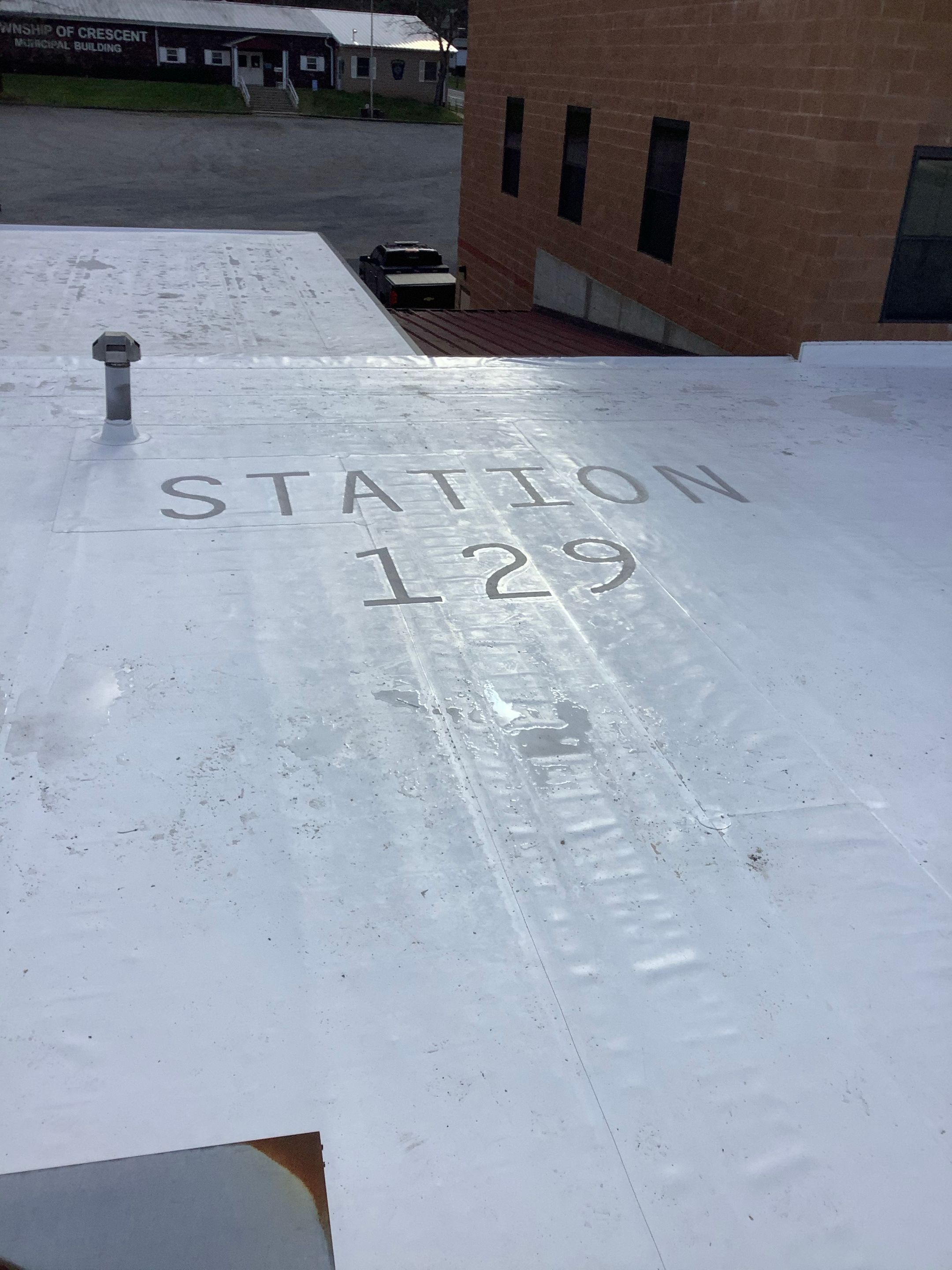 a recently installed commercial roof for fire house station 129in crescent township