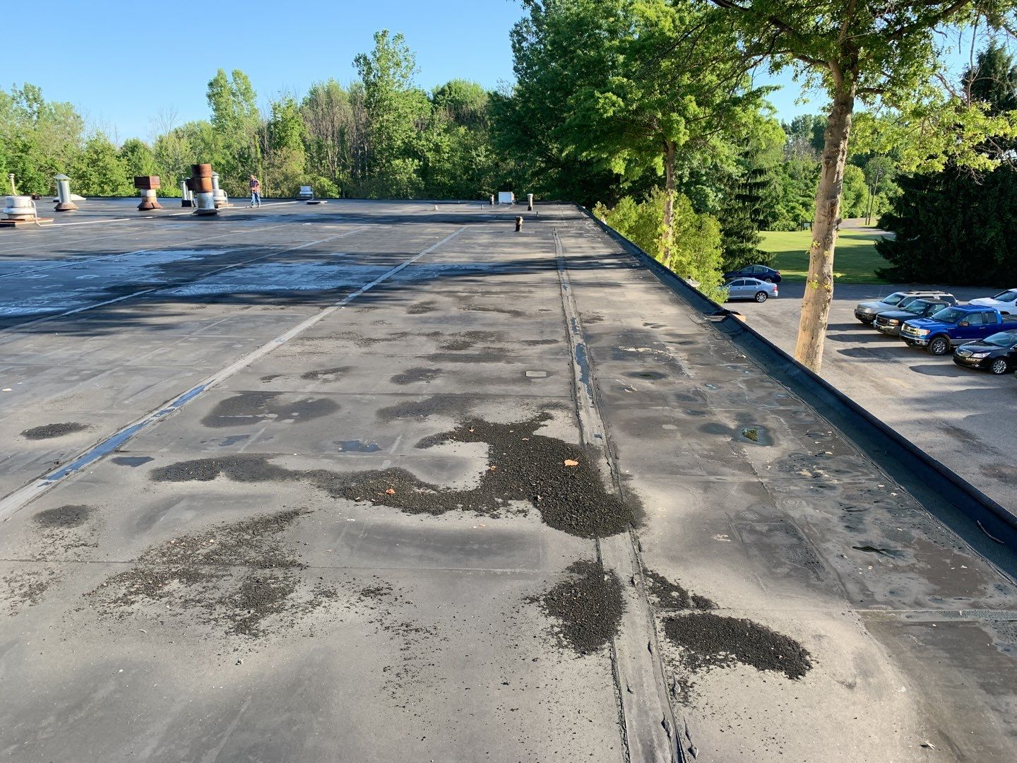 a commercial roof with various ponding and other roof damage