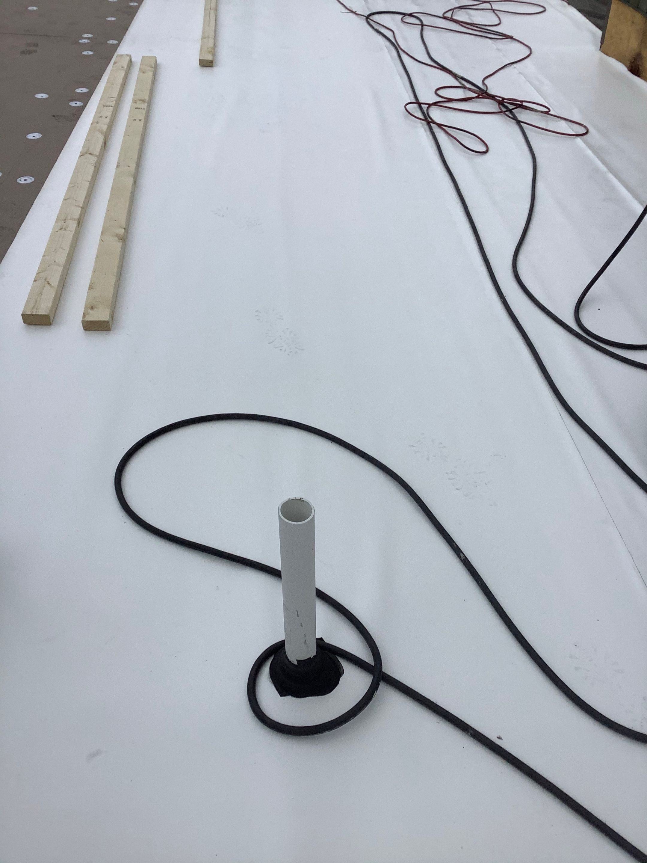 an in-progress installation of a cool roofing system