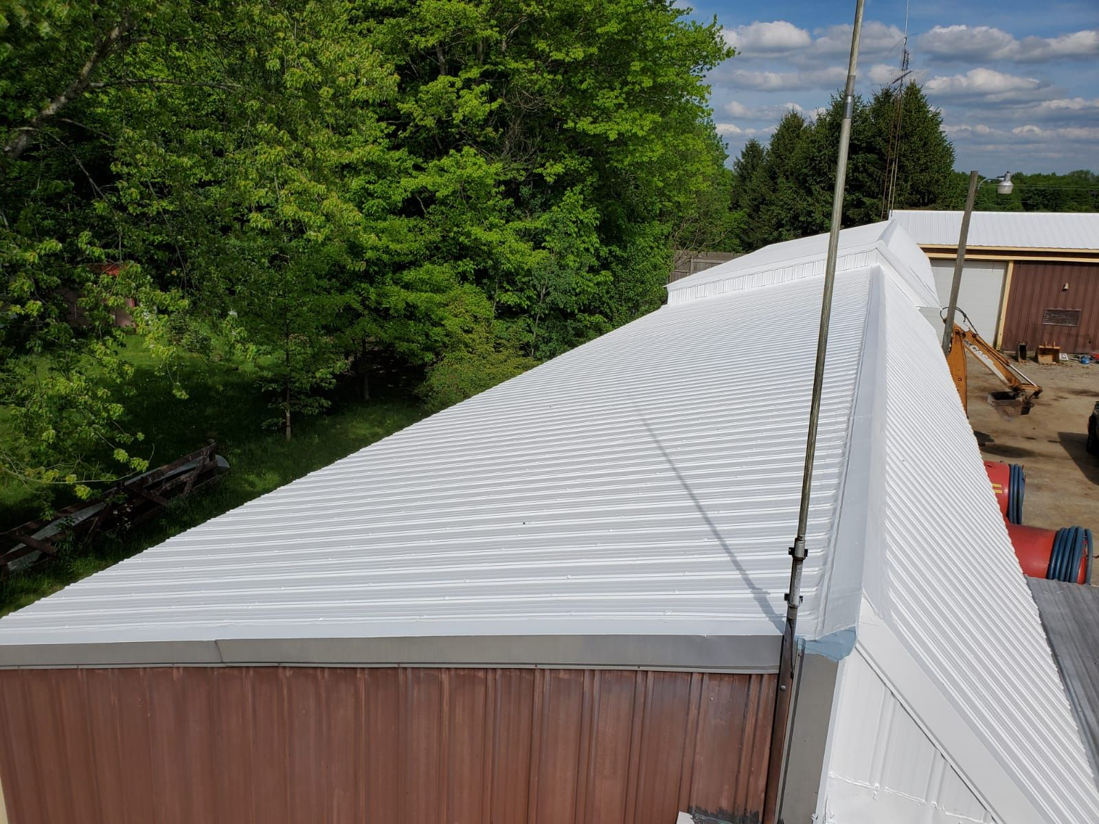 a commercial roof that recently underwent a urethane modified acrylic coating
