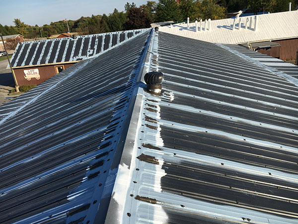 Low-slope metal roof prepped for restoration by Keystone Commercial Roofing