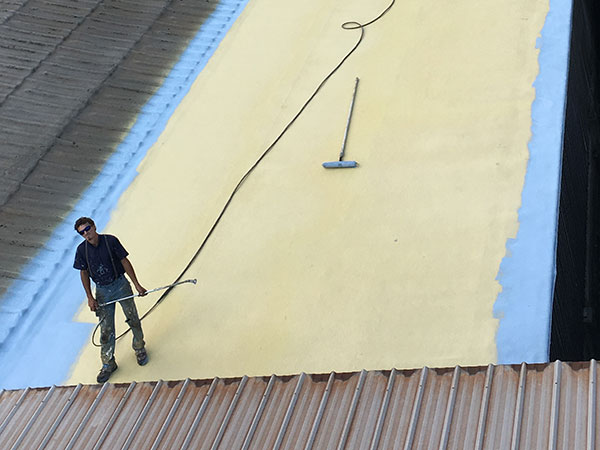 Commercial flat roof being prepped by a roofing expert for restoration