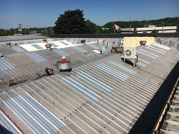 Worn out commercial metal roof