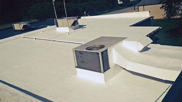 Commercial flat roof restored with a membrane coating by Keystone Commercial Roofing