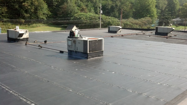 Commercial flat roof in need of restoration