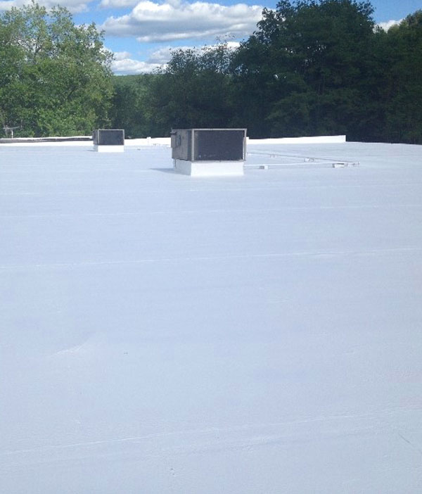 Commercial flat roof restored using a roofing membrane coating system