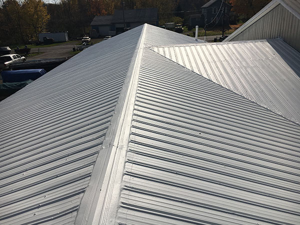 Old, low slope commercial metal roof freshly restored by Keystone Commercial Roofing