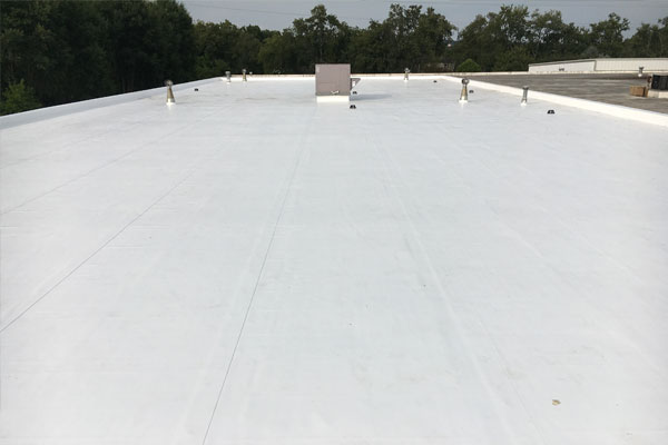 Commercial flat roof restored using a single ply membrane roof system