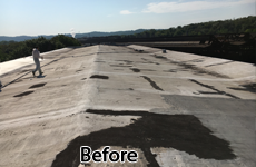 Badly worn commercial low-slope roof