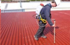 Roofing specialist caulking commercial metal roof