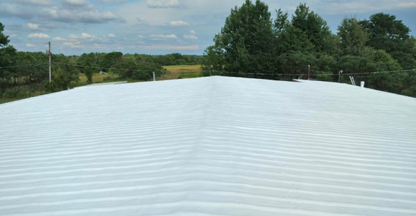 Metal roof that has been restored by applying a membrane coating