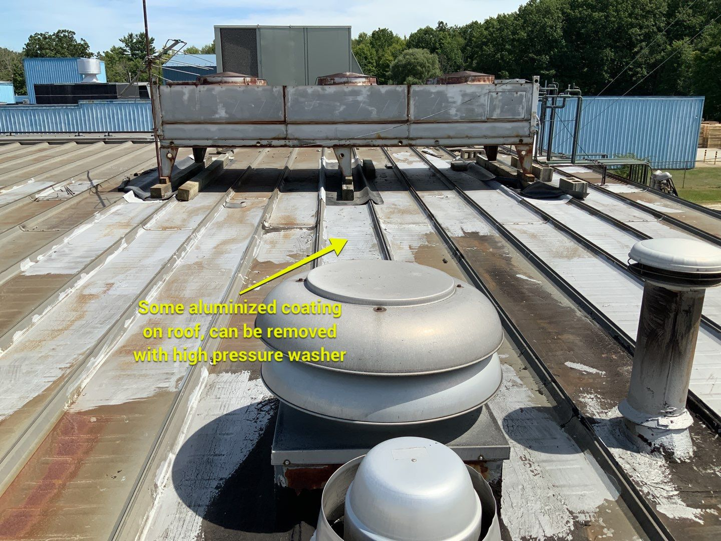 some aluminized coating on roof, can be removed with high pressure washer