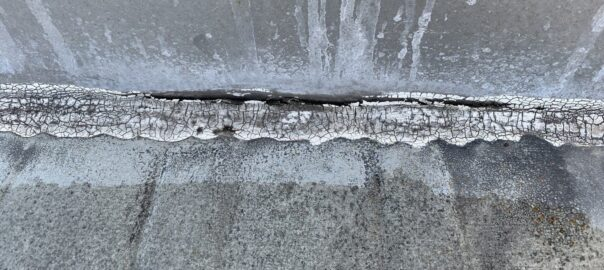 cracked sealant on commercial roof