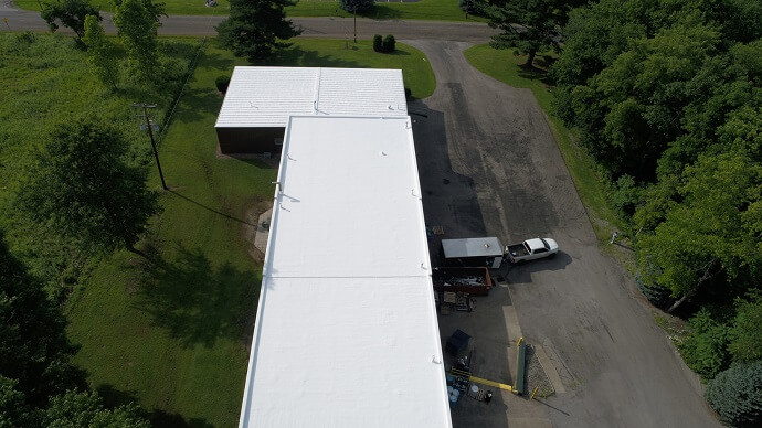 a commercial roof that recently underwent a rubber roof coating